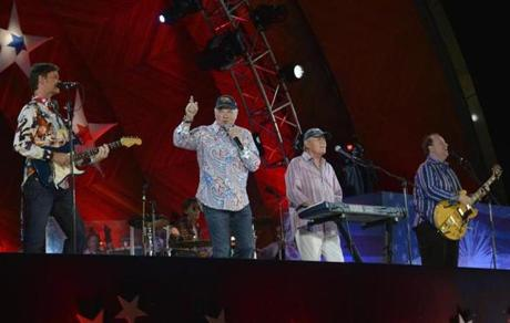 The Beach Boys brought a little California sunshine to the annual Fourth of July concert at the Hatch Shell Thursday before heavy rains and lightning struck.